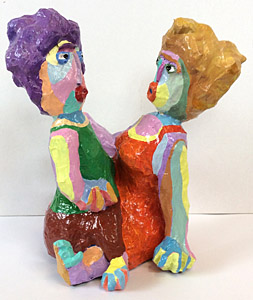 Sculpture Between us by Twan de Vos, man and woman in animated conversation