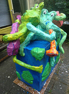 Polyester sculpture Ode to the earth by Twan de Vos, 3 frogs make music, accordion, guitar and wind instrument, singing about the beauty of their surroundings sing