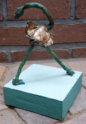 bronze, bronze sculpture of a beautiful bird a proud ostrich