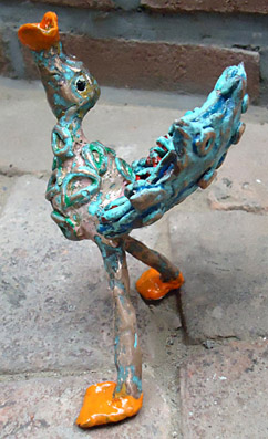 Bronze, bronze sculpture of a bird through a lure is looking for his partner, a trumpet bird